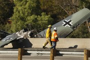 Vintage plane crashes on California highway; pilot survives fiery wreck