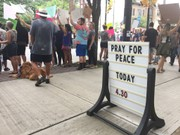 Plopped in the middle of Monday's Trump frenzy, Utica church prays for peace
