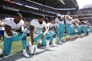 NFL and players union agree to put rules, penalties for anthem protests on hold