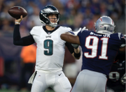 Latest: Eagles' Nick Foles leaves game early with shoulder injury vs. New England Patriots