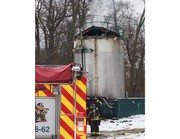 Asphalt tower explosion allegedly caused by worker's propane torch
