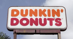 This Thursday, Aug. 3, 2017 file photo shows a Dunkin' Donuts sign at a store in Hialeah, Fla. (AP Photo/Alan Diaz)