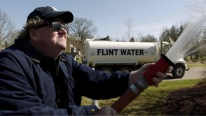 "This image released by State Run Films/Briarcliff Entertainment shows filmmaker Michael Moore in a scene from the documentary ""Fahrenheit 11/9."""