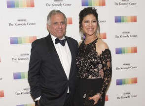 Les Moonves and Julie Chen arrive at the State Department for the Kennedy Center Honors gala dinner, Saturday, Dec. 2, 2017, in Washington. (AP Photo/Kevin Wolf)