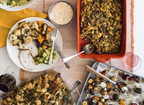 This October 2017 photo provided by Katie Workman shows food on the table at her apartment in New York. When you are making a big Thanksgiving dinner getting as much done ahead of time - and enlisting as much help from family and friends as possible -- makes these epic meals much more enjoyable. (Sarah Crowder/Katie Workman via AP)