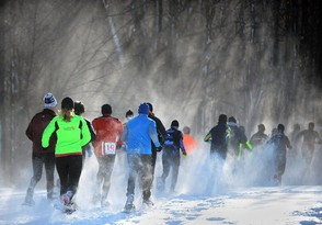 People competing in the 10K race head into the woods at Highland Forest during the Empire State Snowshoe Championships in 2014.