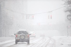 A lake effect band moved back and forth briefly into Syracuse creating low visibility at time and then move out quickly, January 8, 2017. Dennis Nett | dnett@syracuse.com