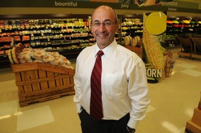 File photo of Frank Curci, Chairman and CEO of Tops Friendly Markets, standing in the Tops store at Town Center in Fayetteville, NY.