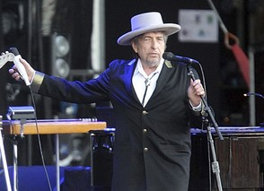 """This July 22, 2012, file photo shows U.S. singer-songwriter Bob Dylan performing onstage at """"Les Vieilles Charrues"""" Festival in Carhaix, western France."""