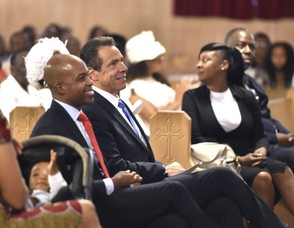 New York Gov. Andrew Cuomo, center left, sits with the congregation at the First Baptist Church of Crown Heights in the Brooklyn, Sunday, Aug. 19, 2018. He is campaigning for a third term in office. (Office of the Governor of New York/Kevin Coughlin via AP) AP
