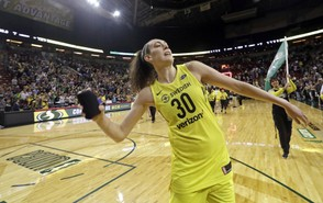 In this Aug. 17, 2018, photo, Seattle Storm's Breanna Stewart tosses a T-shirt to fans after the Storm's 85-77 win over the New York Liberty in a WNBA basketball game, in Seattle. Stewart has taken her game to a new level this year to lead Seattle to the top spot in the league. Her efforts earned her Associated Press WNBA Player of the Year honors on Tuesday, Aug. 21, 2018. (AP Photo/Elaine Thompson, File)