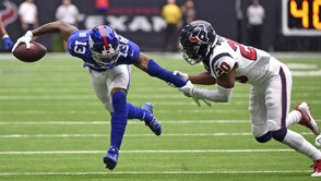 Houston Texans defensive back Justin Reid (20) grabs the arm of New York Giants wide receiver Odell Beckham Jr. (13) during the first half of an NFL football game Sunday, Sept. 23, 2018, in Houston. (AP Photo/Eric Christian Smith)