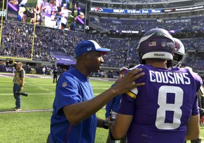 Buffalo Bills defensive coordinator Leslie Frazier greets Kirk Cousins of the Minnesota Vikings after Sunday's game. The Bills defeated the Vikings 27-6.