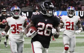 Atlanta Falcons running back Tevin Coleman (26) runs into the end zone for a touchdown against New York Giants free safety Curtis Riley (35) and strong safety Landon Collins (21) during the second half of an NFL football game, Monday, Oct. 22, 2018, in Atlanta. (AP Photo/John Bazemore)