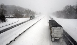 Tractor-trailers use the Thruway in Montezuma this 2015 file photo. Snow could make for slippery driving tonight and Tuesday morning.