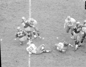 Syracuse end Walt Sweeney runs into Notre Dame kicker Joe Perkowski who then fell into the holder on the last play of the game at Notre Dame Stadium on Nov. 18, 1961. The referee called a roughing the holder penalty and allowed the Irish another kick.