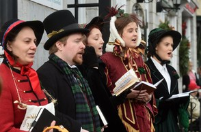 Charles Dickens characters sing Christmas carols on opening day of the Dickens Christmas Festival in Skaneateles ,November 23, 2015.