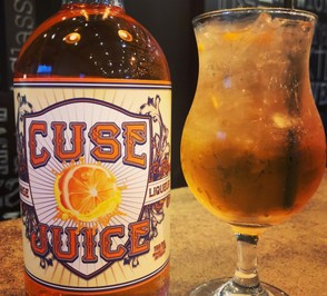 Cuse Juice is a vodka-based orange liqueur from Lock 1 Distilling Co. in Phoenix, Oswego County. It can be drunk on its own, or in cocktails like the Cusesicle (at right).
