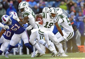 New York Jets returner Andre Roberts carries the ball against the Buffalo Bills during the first half Sunday in Orchard Park, N.Y.