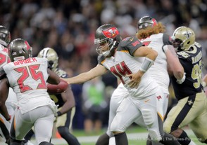 Tampa Bay Buccaneers quarterback Ryan Fitzpatrick (14) hands the ball to Tampa Bay Buccaneers running back Peyton Barber (25) during the first regular season game against the New Orleans Saints on Sept. 9, 2018. (David Grunfeld, NOLA.com | The Times-Picayune)