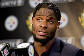 In this Oct. 22, 2017, file photo, Pittsburgh Steelers running back Le'Veon Bell (26) answers questions at a post-game meeting with reporters following a 29-14 win over the Cincinnati Bengals in an NFL football game in Pittsburgh. The Steelers are beginning preparations for their Week 1 opener against Cleveland without All-Pro running back Le'Veon Bell. Bell did not arrive at the team's facility in time for practice on Monday and has yet to sign his one-year franchise tender, leaving his status for Sunday's visit to the Browns in doubt. (AP Photo/Fred Vuich, File)