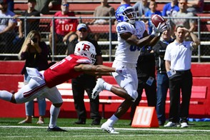 Anthony Johnson #83 of the Buffalo Bulls catches a touchdown pass, the first of the game, against Isaiah Wharton #11 of the Rutgers Scarlet Knights during the first quarter at HighPoint.com Stadium on September 22, 2018 in Piscataway, New Jersey.
