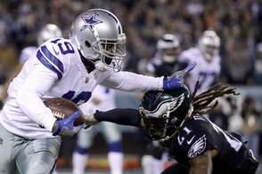 Dallas Cowboys wide receiver Amari Cooper, left, runs with the ball as Philadelphia Eagles cornerback Ronald Darby moves in for the tackle during the first half of an NFL football game, Sunday, Nov. 11, 2018, in Philadelphia. (AP Photo/Matt Rourke) AP