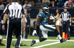 Philadelphia Eagles running back Josh Adams crosses the goal line for a touchdown in the first half of an NFL football game against the New Orleans Saints in New Orleans, Sunday, Nov. 18, 2018. (Butch Dill | AP)