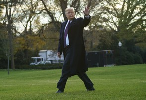 President Donald Trump waves as walks to Marine One after speaking to media at the White House in Washington, Tuesday, Nov. 20, 2018.