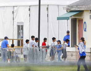 In this June 20, 2018, file photo, Immigrant children walk in a line outside the Homestead Temporary Shelter for Unaccompanied Children a former Job Corps site that now houses them in Homestead, Fla.