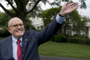 In this May 29, 2018, file photo, Rudy Giuliani, an attorney for President Donald Trump, waves to people at the White House.