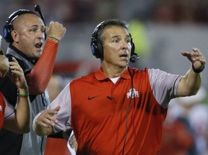 In this Sept. 17, 2016, file photo, Ohio State head coach Urban Meyer, right, and then-assistant coach Zach Smith, left, gesture from the sidelines during an NCAA college football game against Oklahoma in Norman, Okla.