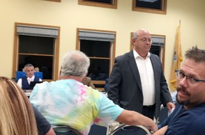 "Phillipsburg Mayor Stephen Ellis leaves the Sept. 18, 2018, town council meeting at the order of Council President Bobby Fulper, seated in background. After the mayor's heated exchange with a councilman, Fulper ejected Ellis for ""egging on"" the audience."