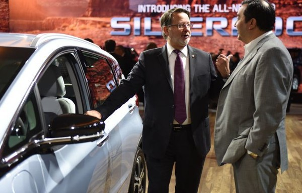 U.S. Sen. Gary Peters looks at the Chevrolet Bolt EV at the Detroit Auto Show on January 16, 2018.