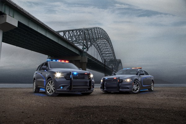 """Dodge expands its police vehicle line-up for 2018 with the new Dodge Durango Pursuit V8 AWD, which joins the Charger Pursuit - the top-selling police sedan in the segment."""