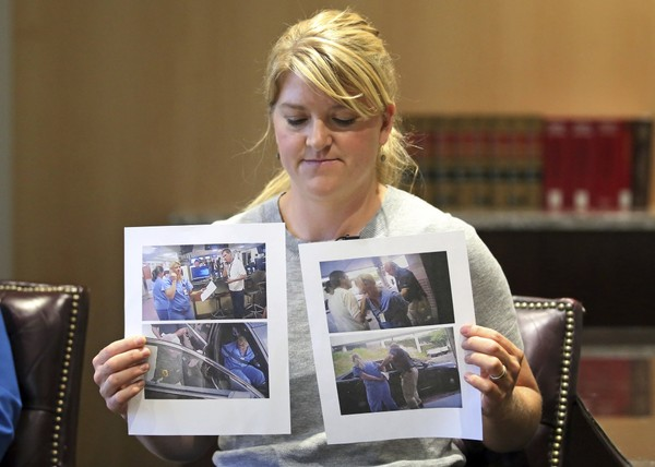 Nurse Alex Wubbels displays video frame grabs from Salt Lake City Police Department body cams of herself being taken into custody, during an interview in Salt Lake City on September 1, 2017.