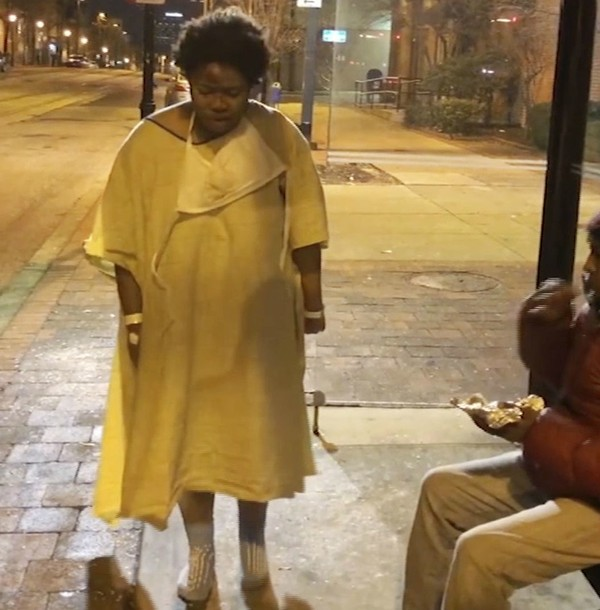 This Tuesday, Jan. 9, 2018, still image taken from video provided by Imamu Baraka shows a woman discharged from a Baltimore hospital wearing only a gown and socks on a cold winter's night. (Imamu Baraka via AP)