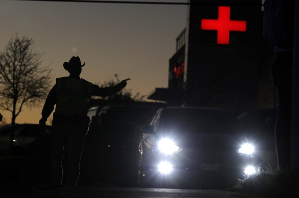 Texas troopers help redirect traffic near the site of another explosion, Tuesday, March 20, 2018, in Austin, Texas.