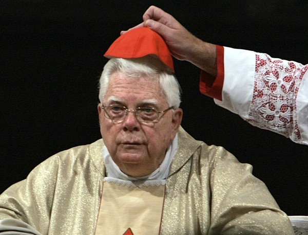 In this Thursday, Aug. 5, 2004 file photo, Cardinal Bernard Law has his skull cap adjusted during the ceremony for Our Lady of the Snows, in St. Mary Major's Basilica in Rome, Italy. (AP Photo/Domenico Stinellis, File)