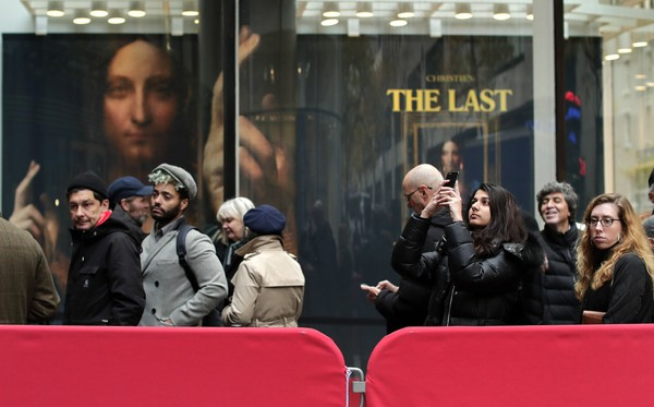 "Visitors to Christie's wait outside in a line to view Leonardo da Vinci's ""Salvator Mundi"" on Tuesday, Nov. 14, 2017, in New York."