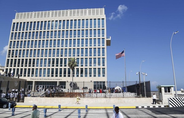 In this Aug. 14, 2015, file photo, a U.S. flag flies at the U.S. embassy in Havana, Cuba. The Associated Press has obtained a recording of what some U.S. Embassy workers heard in Havana, part of the series of unnerving incidents later deemed to be deliberate attacks.(AP Photo/Desmond Boylan, File)