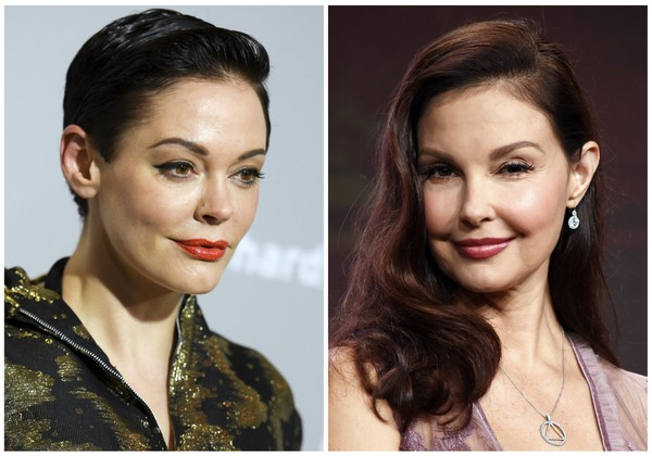Rose McGowan at a premiere in Los Angeles on April 15, 2015, left, and Ashley Judd in Beverly Hilla, Calif. on July 25, 2017.  Producer Harvey Weinstein was fired by his company after The New York Times released a report alleging decades of sexual harassment against women, including employees and actress Ashley Judd. (AP Photo/File)
