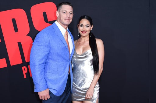 """In this Tuesday, April 3, 2018, photo, John Cena and Nikki Bella attend the Los Angeles premiere of """"Blockers"""" at the Regency Village Theatre."""