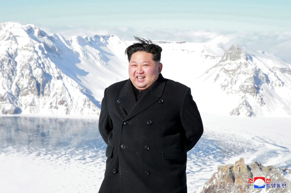 In this undated photo provided on Saturday, Dec. 9, 2017, by the North Korean government, North Korean leader Kim Jong Un smiles as Kim climbed Mt. Paektu, Ryanggang Province, North Korea Independent journalists were not given access to cover the event depicted in this image distributed by the North Korean government.