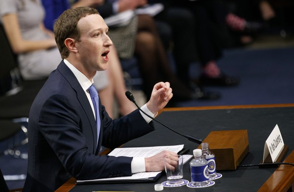 Facebook CEO Mark Zuckerberg testifies before a joint hearing of the Commerce and Judiciary Committees on Capitol Hill in Washington, Tuesday, April 10, 2018, about the use of Facebook data to target American voters in the 2016 election. (AP Photo/Carolyn Kaster)