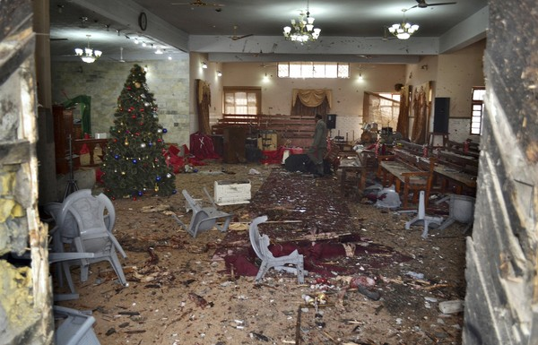 A Pakistani walks in the main hall of a church following a suicide attack in Quetta, Pakistan, Sunday, Dec. 17, 2017.