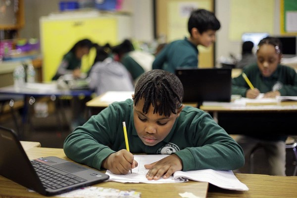 In this Feb. 23, 2017 photo, Justin Beckles works on a project in his third-grade classroom at the Martin Luther King Jr. Elementary School in Hartford, Conn. (AP Photo/Elise Amendola)