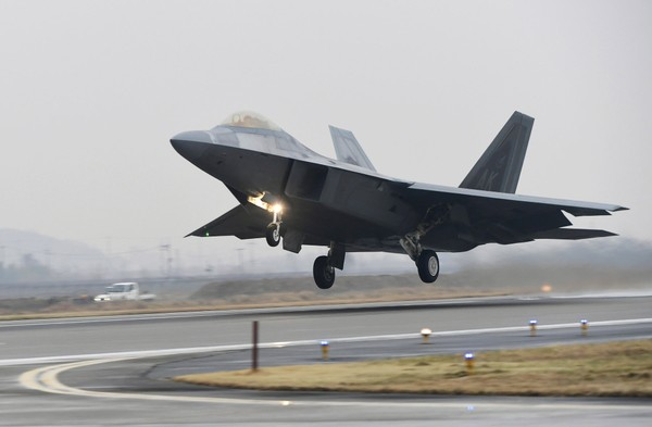 A U.S. Air Force F-22 Raptor takes off from a South Korean air base in Gwangju, South Korea on Monday, Dec. 4, 2017.