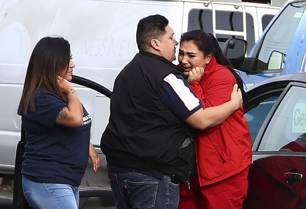 Fernando Juarez, 36, of Napa, center, embraces his 22-year-old sister Vanessa Flores, right, at the Veterans Home of California on Friday March 9, 2018. in Yountville, Calif.