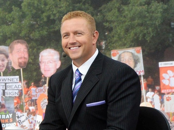 In this photo taken on Aug. 31, 2013, and provied by ESPN, from left, Desmond Howard, Chris Fowler, Lee Corso and Kirk Herbstreit smile on the set of College GameDay at Clemson Memorial Stadium in Clemson, S.C.  (AP Photo/Courtesy ESPN Images, Allen Kee)
